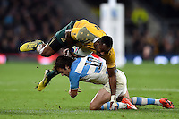 Tevita Kuridrani of Australia is tackled by Nicolas Sanchez of Argentina. Rugby World Cup Semi Final between Argentina v Australia on October 25, 2015 at Twickenham Stadium in London, England. Photo by: Patrick Khachfe / Onside Images