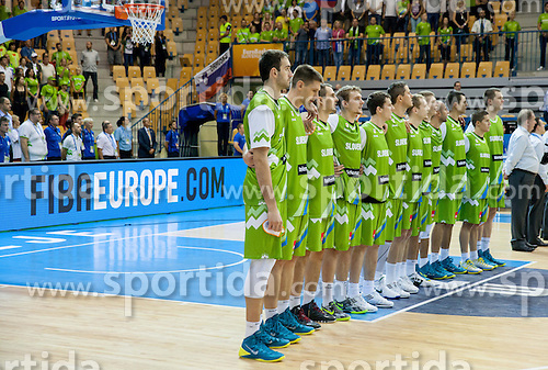 Players of Slovenia listening to the national anthem during basketball match between National teams of Georgia and Slovenia in Round 1 at Day 4 of Eurobasket 2013 on September 7, 2013 in Arena Zlatorog, Celje, Slovenia. (Photo by Vid Ponikvar / Sportida.com)