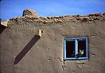 cat in window at Taos Pueblo