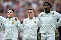 Danny Care, George Ford and Maro Itojoe of England sing the national anthem. RBS Six Nations match between England and Scotland on March 11, 2017 at Twickenham Stadium in London, England. Photo by: Patrick Khachfe / Onside Images