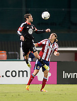 Chris Pontius (13) of D.C. United goes up for a header with Ben Zemanski (21) of Chivas USA during the game at RFK Stadium in Washington, DC.  D.C. United defeated Chivas USA, 1-0.