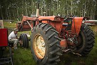 Yves Breton tends on his 1967 Cockshutt 1650 tractor in Saint-Laurent, Manitoba, Wednesday August 12, 2015.