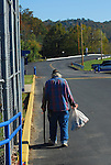 B.J. 'Tin Can Man' Miller walked by the High School on Oct. 15th in his perpetual search for aluminum cans. .Photo by Sam Verbulecz