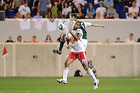 Thierry Henry (14) of the New York Red Bulls and Eric Brunner (5) of the Portland Timbers. The New York Red Bulls defeated the Portland Timbers 2-0 during a Major League Soccer (MLS) match at Red Bull Arena in Harrison, NJ, on September 24, 2011.