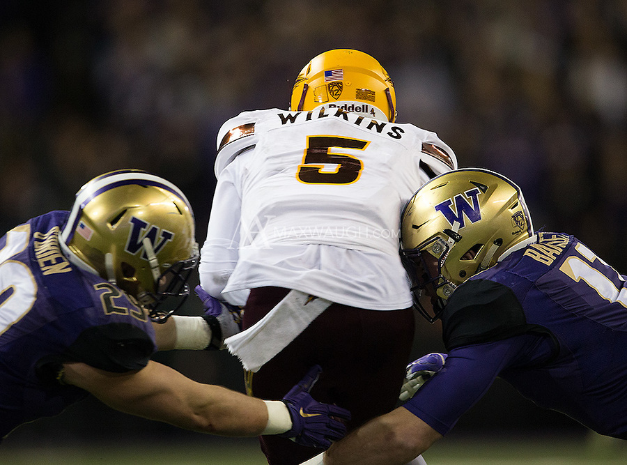 Manny Wilkins is sandwiched by Connor O'Brien and Tevis Bartlett.