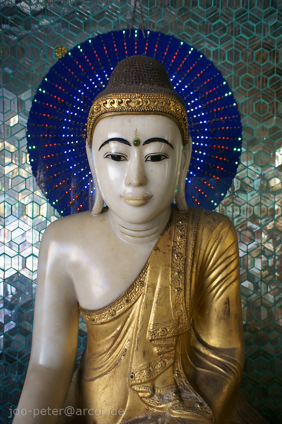 golden Buddha sculpture in a shrine of  Shwedagon pagoda complex, Yangon, Myanmar, 2011