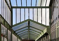 Desert and Arid Lands Glasshouse, 1930s, Jardin des Plantes, Museum National d'Histoire Naturelle, Paris, France. Low angle view showing the glass and metal structure of the walls and roof.