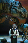 Jonathan Bliss, who portrays Huxley, the paleontologist, speaks to the audience as a Tyrannonsurus Rex mother takes care of it's baby at the Tacoma Dome in Tacoma, Washington on July, 11, 2007. 15 dinosaurs, which roamed the earth about 208 million years ago, have been brought back to life via truck batteries, hydraulics and puppeteers in the 90-minute show, Walking with Dinosaurs - The Live Experience, based on the award-winning BBC Television series kicked off it's seven city Summer tour in the U.S. and Canada.(&copy; 2007 Jim Bryant Photography).