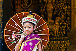 A girl wearing traditional cloathes and umbrella during the Lao New Year (Pi Mai) celebrations in Luang Prabang, Laos.