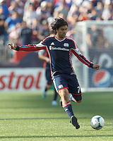 New England Revolution midfielder Juan Carlos Toja (7) passes the ball.  In a Major League Soccer (MLS) match, the New England Revolution (blue) defeated LA Galaxy (white), 5-0, at Gillette Stadium on June 2, 2013.
