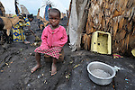 In the eastern Congo, a girl displaced by fighting between rebels and government forces took refuge with her family in a displaced persons camp set up on a lava flow in the village of Nzulu. Action by Churches Together (ACT International) has provided safe drinking water, latrines, and other support to families here, as well as to many residents of the host village. A quarter of a million people have been newly displaced by fighting in the eastern Congo, where some 5.4 million have died since 1998 from war-related violence, hunger and disease.
