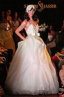 Model walks the runway in a Celestial wedding dress - strapless beaded silk organza Ball-gown, by Sarah Jassir, for the Sarah Jassir Couture Bridal Fall 2012 Opulence collection.