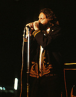 Jim Morrison - The Doors.- .This is one of the most tragic stories in popular music.  Jim Morrison had been considered one of the worlds most beautiful people in the late 1960s, and then shortly afterwards, such as at IOW in 1970, he was having the lights dimmed at his shows to hide his untimely demise.   Weight gain, alcohol and drug addiction could have led to his death in 1971 of a suspected heroin overdose.  .Like Janice Joplin, Jimi Hendrix and more recently Amy Winehouse, he died at the age of 27.