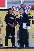Oct. 28, 2012; Las Vegas, NV, USA: NHRA announcer Bob Frey (right) interviews Eddie Krawiec during the Big O Tires Nationals at The Strip in Las Vegas. Mandatory Credit: Mark J. Rebilas-