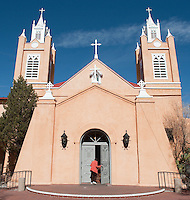 Woman Entering A Church In Santa Fe, New Mexico
