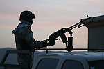 An Iraqi soldier mans a PKM machine gun in the back of a pickup truck during an operation targeting insurgents in the town of Al Cheb Allib, Iraq. Nov. 29, 2007. DREW BROWN/STARS AND STRIPES