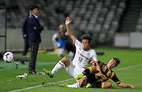 Japan's Sanfrecce Hiroshima Yoshifumi Kashiwa (18) and Central Coast Mariners  Nick Fitzgerald during their AFC Champions League match in Gosford, near Sydney, March 11, 2014. VIEWPRESS/Daniel Munoz EDITORIAL USE ONLY