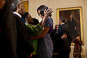 United States President Barack Obama and First Lady Michelle Obama greet guests during a reception in honor of the groundbreaking of the Smithsonian National Museum of African American History and Culture, in the East Room of the White House, February 22, 2012. .Mandatory Credit: Pete Souza - White House via CNP