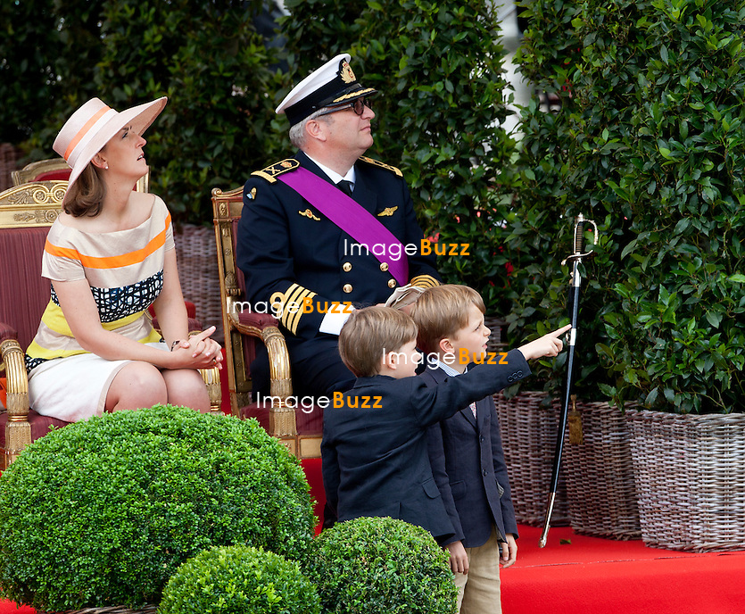 Princess Claire of Belgium, Prince Laurent of Belgium and their twin sons Prince Nicolas and Prince Aymeric pictured during a military parade on the occasion of today's Belgian National Day, Saturday 21 July 2012 in Brussels.