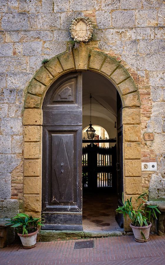 SAN GIMIGNANO, ITALY - CIRCA MAY 2015:  Typical entryway and door in San Gimignano in Tuscany