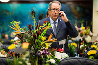 TALLAHASSEE, FLA. 3/3/15-Surrounded by flowers to commemorate the opening day of the 2015 Legislative Session, Rep. Ray Pilon, R-Sarasota, fields a call prior to the start of work Tuesday at the Capitol in Tallahassee.<br /> <br /> COLIN HACKLEY PHOTO