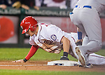 13 October 2016: Washington Nationals outfielder Trea Turner steals third base during Game 5 of the NLDS against the Los Angeles Dodgers at Nationals Park in Washington, DC. The Dodgers edged out the Nationals 4-3, to take Game 5 of the Series, 3 games to 2, and move on to the National League Championship Series against the Chicago Cubs. Mandatory Credit: Ed Wolfstein Photo *** RAW (NEF) Image File Available ***