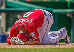 27 April 2014: Washington Nationals second baseman Danny Espinosa writhes in pain after getting hit by an Ian Kennedy pitch leading off the bottom of the second inning against the San Diego Padres at Nationals Park in Washington, DC. The Padres defeated the Nationals 4-2 to to split their 4-game series. Mandatory Credit: Ed Wolfstein Photo *** RAW (NEF) Image File Available ***
