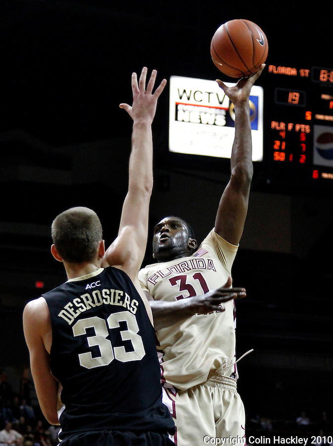 TALLAHASSEE, FL 2/1/11-FSU-WF MBB11 CH-Florida State's Chris Singleton shoots around Wake Forest's Carson Desrosiers during first half action Tuesday at the Donald L. Tucker Center in Tallahassee...COLIN HACKLEY PHOTO