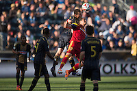 Austin Berry (4) of the Philadelphia Union goes up for a header with Devon Sandoval (49) of Real Salt Lake. Real Salt Lake and the Philadelphia Union played to a 2-2 tie during a Major League Soccer (MLS) match at PPL Park in Chester, PA, on April 12, 2014.
