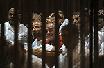 Egyptian Muslim Brotherhood leader Mohammed Badie sits behind the defendant's cage as he attends his trial, at a court in the outskirts of Cairo, Egypt, Dec. 07, 2015. Photo by Amr Sayed
