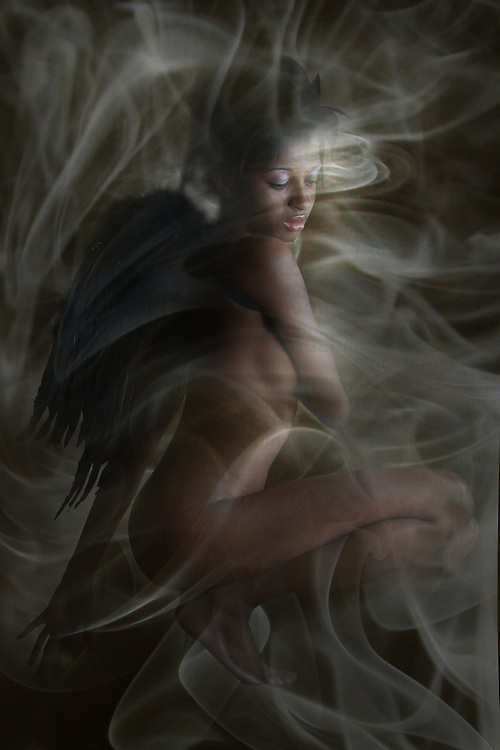 artistic nude angel in swirls of mist