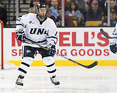Brett Kostolansky (UNH - 15) - The Merrimack College Warriors defeated the University of New Hampshire Wildcats 4-1 (EN) in their Hockey East Semi-Final on Friday, March 18, 2011, at TD Garden in Boston, Massachusetts.