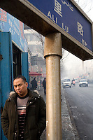 People walk along the streets of Urumqi, Xinjiang, China. The city is divided between Han and Uighur ethnicities, and violent clashes erupted between the groups in 2009.