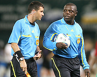 Referee Abiodun Okulaja (r) during an MLS match against FC Dallas at RFK Stadium in Washington D.C. on August 14 2010.Dallas won 3-1.