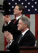 United States President Bill Clinton is joined by U.S. Vice President Al Gore, as he applauds Lyn Gibson and Wei Ling Chestnut, the widow of two Capitol police officers who were killed in 1998 as he begins the State of the Union Address during a Joint Session of Congress in Washington, D.C. on January 19, 1999.                                                                                                               .Credit: Win McNamee / Pool via CNP