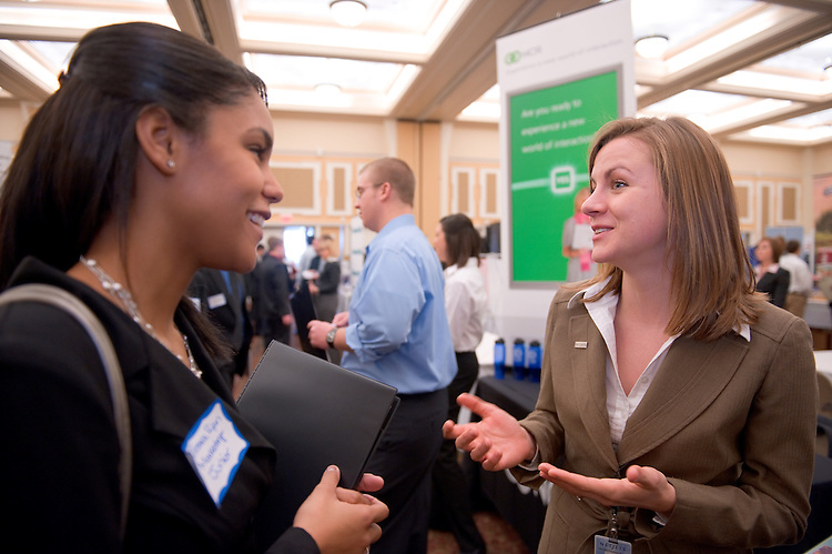 19186Career Fair in Baker Center Ballroom   2/03/09...Jessica Ryan, student talks to Jessica McMillen from NetJets, in Columbus,OH