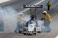 Apr. 6, 2013; Las Vegas, NV, USA: NHRA safety safari crews put out a fire on the car of top fuel dragster driver Brandon Bernstein during qualifying for the Summitracing.com Nationals at the Strip at Las Vegas Motor Speedway. Mandatory Credit: Mark J. Rebilas-