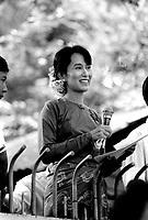 Daw Aung San Suu Kyi, the Nobel Peace Prize Laureate and General Secretary of the National League for Democracy (NLD), delivering her Saturday speech to supporters from the gates outside her home.