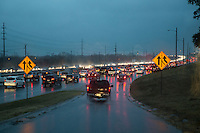 Cars jockey for lane position entering the on-ramp on the Mopac Expressway (Loop 1) during morning rush hour during a rain storm in northwest Austin, Texas.