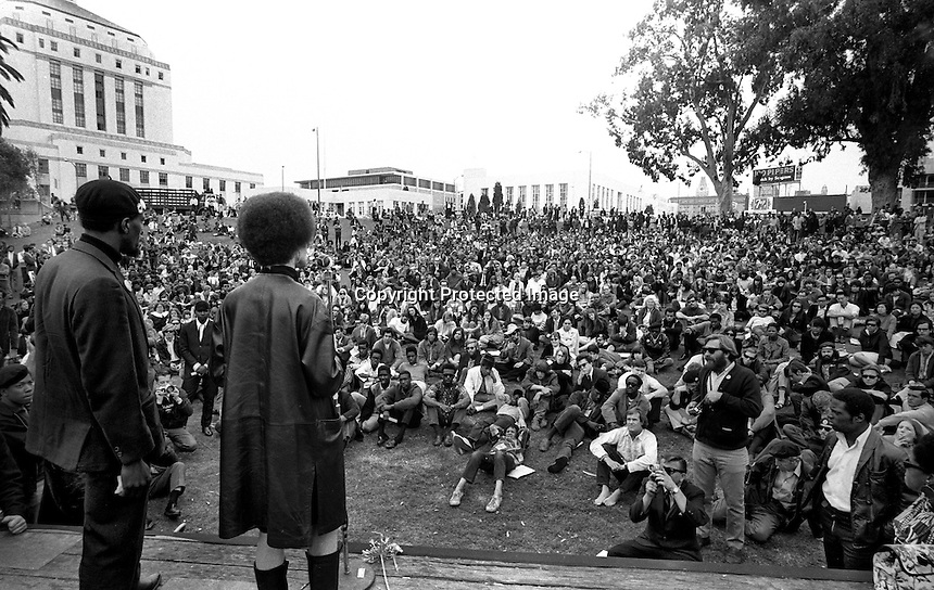 Black Panther rally at Lakeside Park in Oakland, Caif.<br /> William Lee Brent and Kathleen Cleaver standing speaking to big crowd. The rally was held just after the funeral service for Panther Bobby Hutton who was killed in a shootout with Oakland Police a week before. (photo April 12,1968 by Ron Riesterer)(copyright@1968)