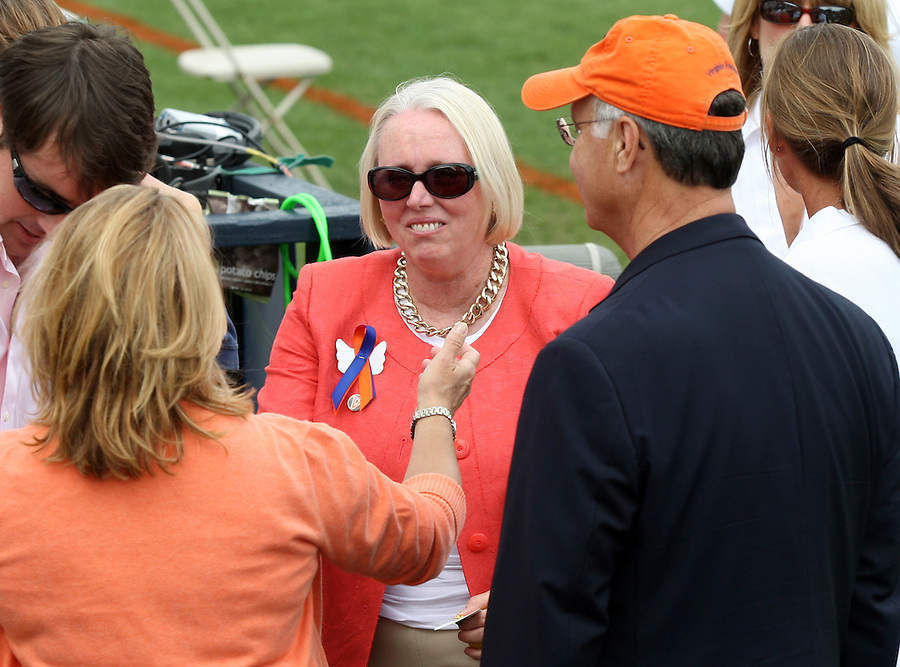 University of Virginia president John Casteen, right, and his wife Betsy Foote Casteen, left, say goodbye to Sharon Donnelly, middle,  the mother of slain Virginia women's lacrosse player Yeardley Love, after the Virginia 14-12 win over Towson during the 1st round of NCAA play Sunday May 16, 2010 at Klockner Stadium in Charlottesville, Va. The Cavaliers rallied in the last four minutes to beat Towson 14-12 Sunday and reach the quarter finals of the NCAA tournament. Love's body was found May 3, and Virginia men's lacrosse player George Huguely is charged with murder. Photo/Andrew Shurtleff..