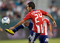Chivas USA midfielder Rodolfo Espinoza (24) clears a ball from the area. CD Chivas USA defeated the Columbus Crew 3-1 at Home Depot Center stadium in Carson, California on Saturday July 31, 2010.