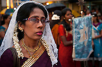 Lady who is part of a larger group of women who lead the procession round the streets of Colombo 13..Final day of the St. Anthony's festival at Kochchikade, Colombo 13.