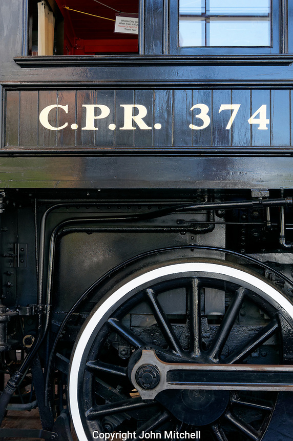 Drive wheel and cab of the Restored CPR Engine 374 at the Roundhouse in Yaletown, Vancouver, British Columbia, Canada.