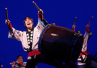 NEWS&GUIDE PHOTO / PRICE CHAMBERS.Naomi Guilbert, left, is joined by Nikki Yoshikawa, right, and Hiroshi Koshiyama, lower left, as they pound traditonal Japanese drums called taiko.