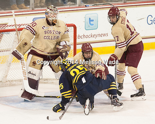 Thatcher Demko (BC - 30), Max Shuart (Michigan - 25), Scott Savage (BC - 2), Destry Straight (BC - 17) - The Boston College Eagles defeated the visiting University of Michigan Wolverines 5-1 (EN) on Saturday, December 13, 2014, at Kelley Rink in Conte Forum in Chestnut Hill, Massachusetts.