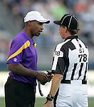 Minnesota Vikings' head coach Leslie Frazier,  questions a call by Side Judge Greg Meyer, against the Seattle Seahawks in the first quarter of a pre season game on Saturday August, 2011 at CenturyLink Field in Seattle.  The Vikings beat the Seahawks  20-7. ©2011 Jim Bryant Photo. All Rights Reserved.