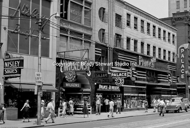 Pittsburgh PA:  View east on Liberty Avenue toward Pennsylvania Railroad Station - 1959.  Businesses on the north side (600 block) of the street include: Nisley Shoes, Wilkens Jewelers, and Palace Jewelers