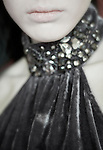 Close up of beautiful teenagers lips in very elegant dress filled with shining stones