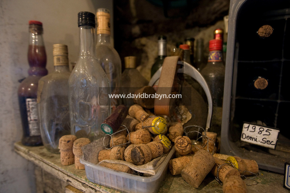 Corks and bottle lie on a table at the entrance to winemaker Daniel Jarry cellars in Vouvray, France, 26 June 2008.